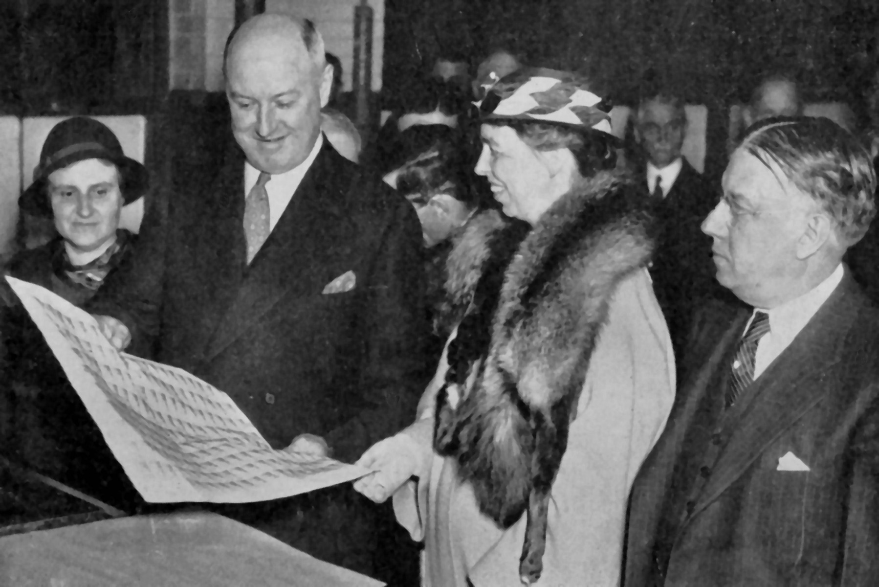 James Farley and Eleanor Roosevelt examining the Mother's Day stamps