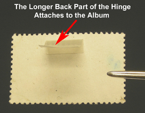 Stamp with small part of hinge attached